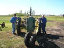 My dad, a John Deere Model A, and my dad's best friend Richard Wilwont.