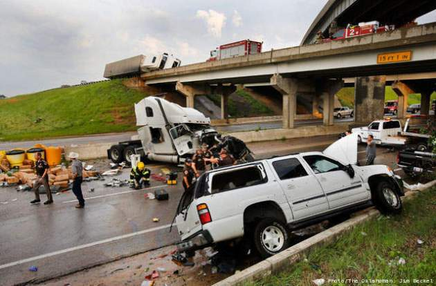 On Interstate 40 near Shawnee, Oklahoma: The May 19th 2013 tornado blew these big trucks off overpasses and tossed them around like toys.  Photo courtesy Daily Oklahoman.